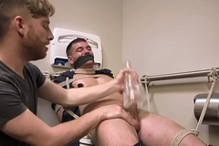Male sub restrained  be fitting of bed blowjob