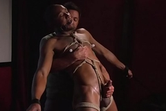 Bound black gay receives a handjob 'til cumshot