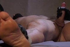 Bound clog gets a tugjob from masked dudes