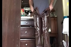 man in penurious glittering brown leather panties wanking
