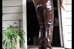 man in tight shiny pessimistic leather pants masturbating Outside