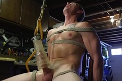 Bound submissive gay gets cock tugged close to BDSM